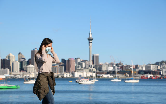 A girl using a mask after second wave of Covid 19 in Auckland CBD New Zealand