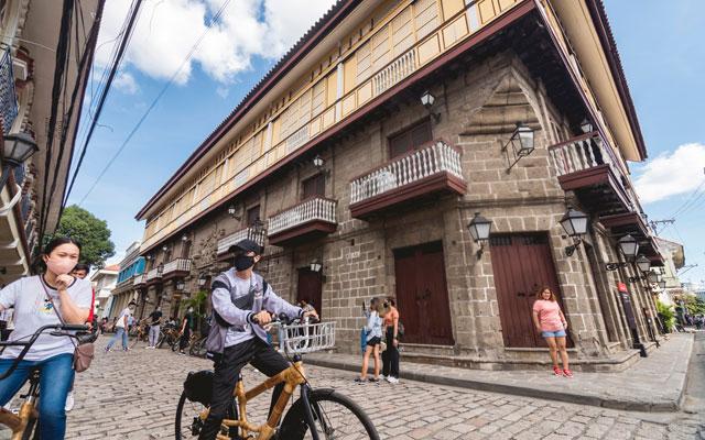 Tourists at Casa Manila in Intramuros Manila Philippines